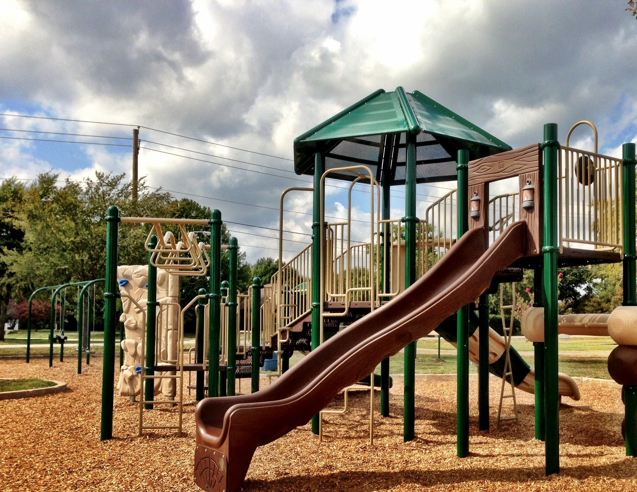 Green and brown jungle gym